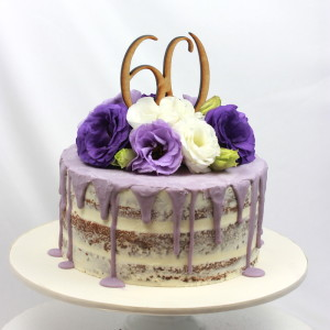 60th Birthday semi naked cake with purple drizzle