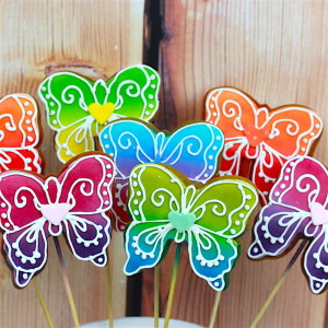Multicoloured butterfly cookie pops